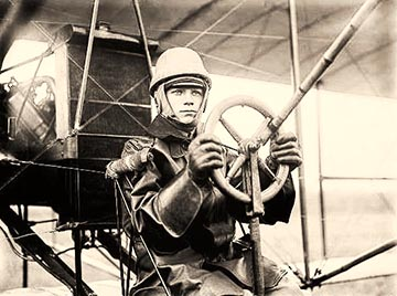 A pilot flying a Curtiss aircraft